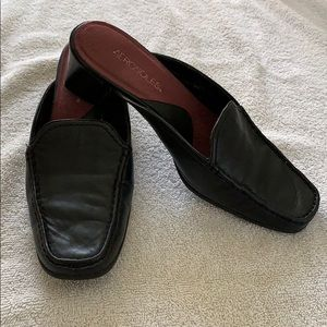 Black buttery leather mules